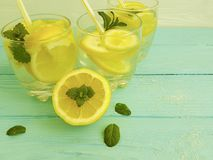Water soda lemon citrus natural refreshment , freshness homemade health mint summer on a blue wooden background. Water lemon antioxidant mint blue wooden Royalty Free Stock Photos