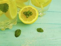 Water soda lemon tropical organic refreshment , freshness homemade health mint summer on a blue wooden background. Water lemon antioxidant mint blue wooden Stock Photos