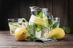 Water with lemon, cucmber and ginger. Selective focus Royalty Free Stock Photos