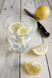 Water and lemon Stock Images