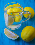 Water with a lemon in a glass Stock Photos