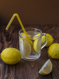 Water with a lemon in a glass Stock Images