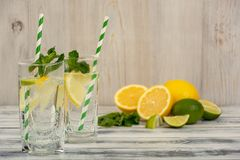 Water with lemon and ice Stock Images