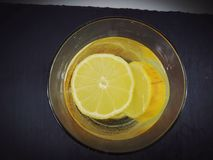 Water lemon juice glass plate. Drink yellow drinking background Royalty Free Stock Image
