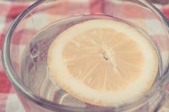 Water with lemon juice in a transparent mug Stock Image