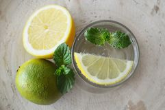 Water, lemon and lime stock image