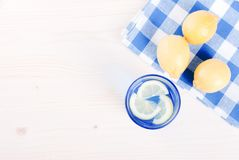 Water with lemon and mint in blue glass on the table top view Royalty Free Stock Photography