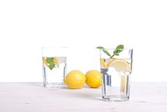 Water with lemon and mint in a glass on the table side view of i Stock Photography