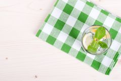 Water with lemon and mint in a glass on the table top viewew Stock Photos