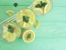 water with lemon and mint organic on a wooden Royalty Free Stock Images