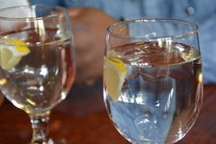 Water with Lemon. Two glasses of water with a twist of lemon Stock Image