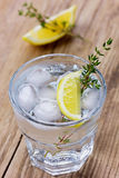 Water with lemons and ice decorated herb thyme Royalty Free Stock Images