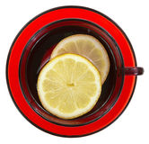 Water with lemons in red cup and saucer Stock Image
