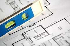 Water level and architectural plans. Water level and architectural plan , home building concept Royalty Free Stock Photos