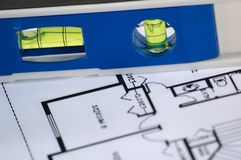 Water level and architectural plans. Water level and architectural plan , home building concept Stock Image