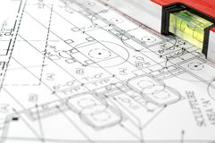 Water level and architectural plans. Water level and architectural plan , home building concept Royalty Free Stock Image