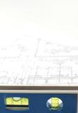 Water level and architectural plans. Water level and architectural plan , home building concept Royalty Free Stock Photography