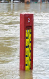 Water level indicator in a flooded river Royalty Free Stock Photos