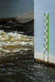 Water level measurement gauge during flood. Flood disaster. Royalty Free Stock Photo