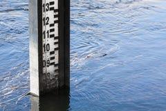 Water level measurement gauge. Water level measurement gauge used to monitor the water levels. Water level measurement during flood Stock Images