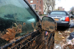 Water level and mud at cars in the Sheepsheadbay stock photography