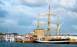 Water Level View of a Tall Ship. This water level view is of a sail training, tall ship, located at the entrance to Weymouth Harbour in the South of England Royalty Free Stock Photography