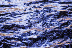 Water level, water in motion. Reflected structure of the surroundings is distorted by the movement of water. Abstract blue backgro Royalty Free Stock Photography