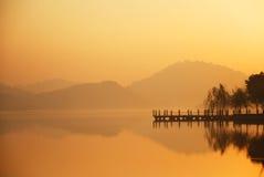 Water lian lake breeze light. Chinese Guangdong Dongguan Shui Lianhu dawn. Golden color Chaoyang dyes the level of the lake golden yellow Stock Photography