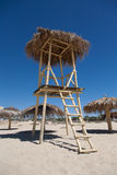 Water lifeguard watchtower. Water lifeguard wooden watchtower standing on a beach royalty free stock photos
