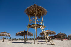 Water lifeguard watchtower. Water lifeguard wooden watchtower standing on a beach stock images