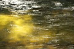 Water and light golden yellow background. Water and light golden yellow abstract background Royalty Free Stock Photo