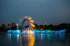 Water Light Show in Astana, Kazakhstan. The light show every evening on the river flowing through Astana Kazahstan, where many people gather to watch royalty free stock photos