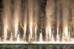 Water and light show of Dubai Mall fountains. Water and light show of the Dubai Mall fountains on a late evening. Dubai, UAE Stock Photography