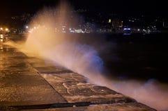 Water and light splash Stock Photos