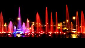 Water lights. Fountain Colors Light in water night photography Estoril Portugal Garden at night city life Stock Photo