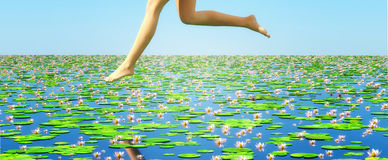 Water lilies. Girls floating over pond of lilies Royalty Free Stock Photos