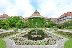 Water lily pond in front of Botanical Institute building in Munich Botanical Garden Stock Photo
