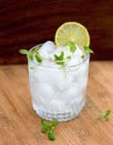 Water with lime in a glass Stock Image