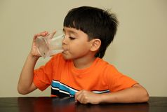 Water. A little boy drinking fresh water from a glass Royalty Free Stock Photos