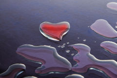 Water Love. Heart shape made with water dropsThis is the 13000000th image online Stock Image