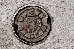 Water main manhole cover royalty free stock images
