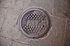 Water manhole cover in New Orleans Stock Images