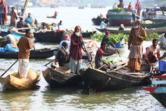 Water market. Men selling their goods on a floating market in Bangladesh Stock Photography