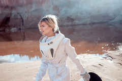 Water on Mars, futuristic astronaut without a Stock Photos