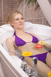 Water massage at the spa. Water massage concept with a beautiful woman at the spa royalty free stock image