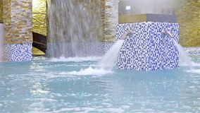 Water massage, stream of clear blue water stock video footage