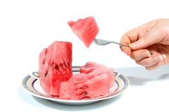 Water - melon. Slice and fork Stock Photos