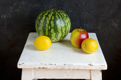 Water melon,apple and lemon on white seat Stock Photos