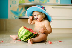 Water-melon and baby girl Stock Photos