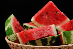 Water-melon in basket 2. Water-melon in basket on dark background Royalty Free Stock Images